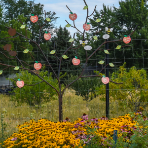 a tree made from metal decorating a garden