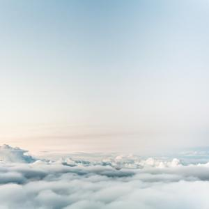 Photo of clouds and the very peaks of a mountain range
