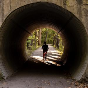 Bicyclist through a tunnel in Cuyahoga National Park.