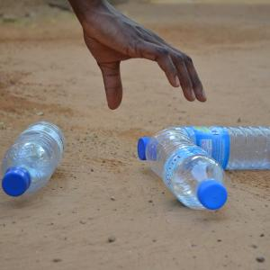 Picking up plastic bottle