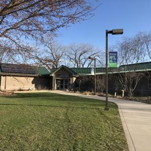 The entrance to Anita Purves Nature Center, where solar panels sit atop the building.