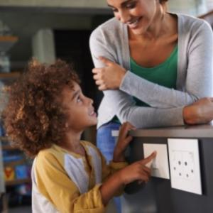 Woman and child looking at electrical outlets