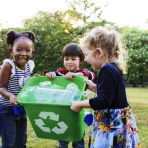Three children recycling