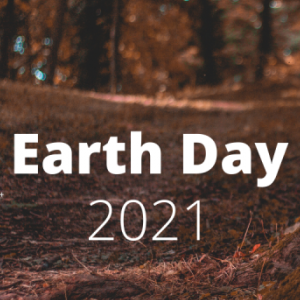 image of tree trunk and Earth Day 2021 in white type