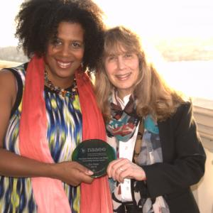 NAAEE Executive Director Judy Braus presents Outdoor Afro Founder Rue Mapp with NAAEE's Rosa Parks and Grace Lee Boggs Award in 2015.