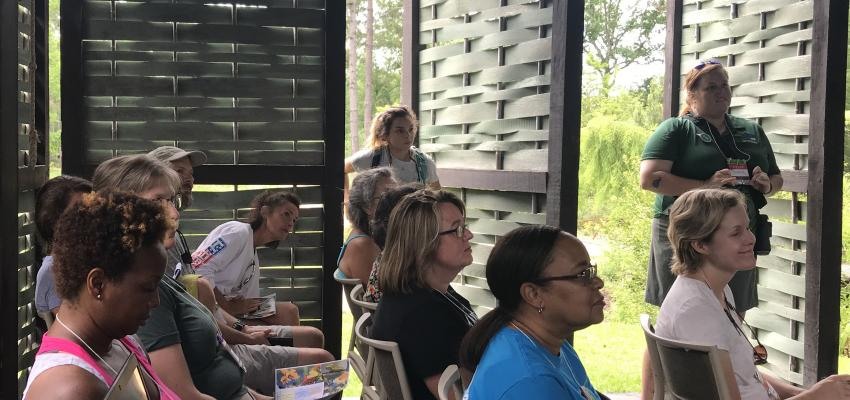A group of environmental educators listening to a session during the annual EEASC Conference.